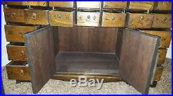 69 Drawer Apothecary Chest Cupboard with Brass Hardware & dark / honey finish